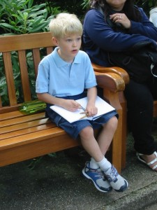 Tommy drawing at Monet's gardens