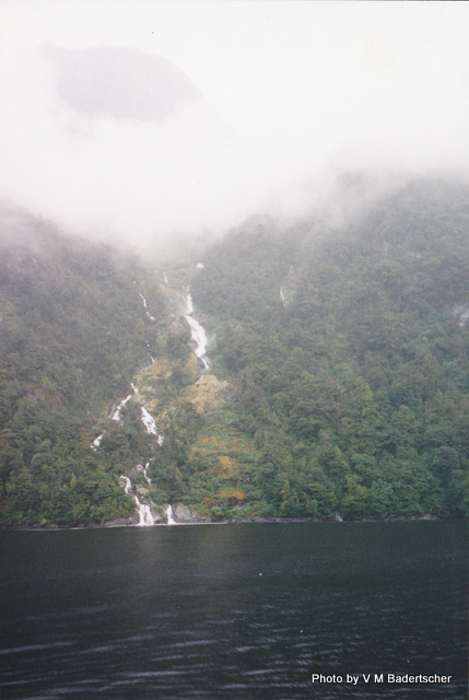 Multiple waterfalls at Doubtful Sound on a rainy day.