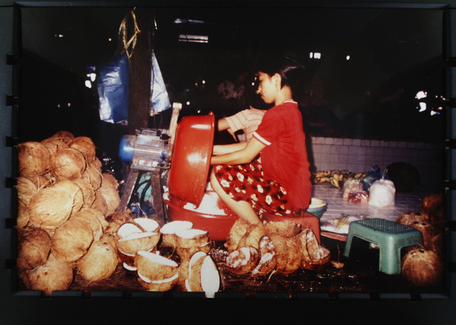 Coconut seller, market in Siem Riep