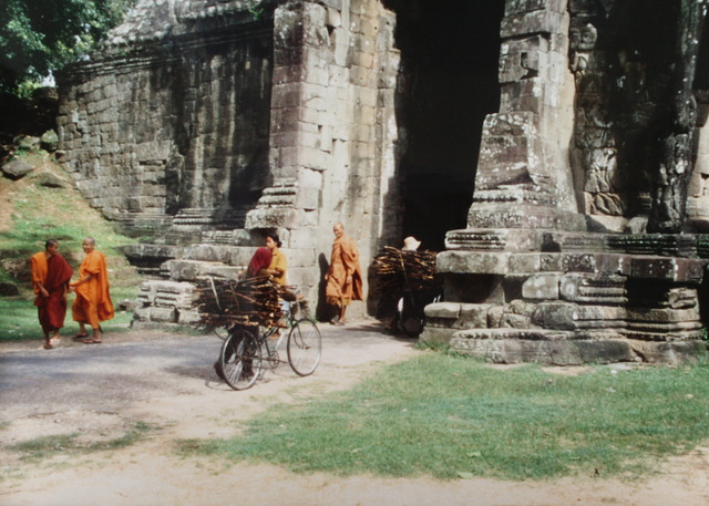 Monks and wood sellers outside Angkor Thom