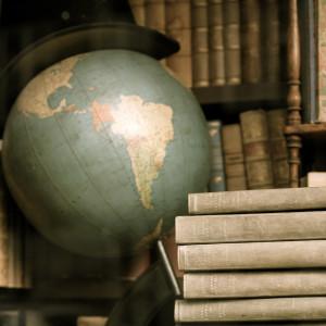 around the world globe and books