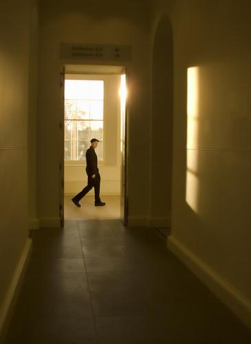Man walking in London. Photo by Stu Mayhew